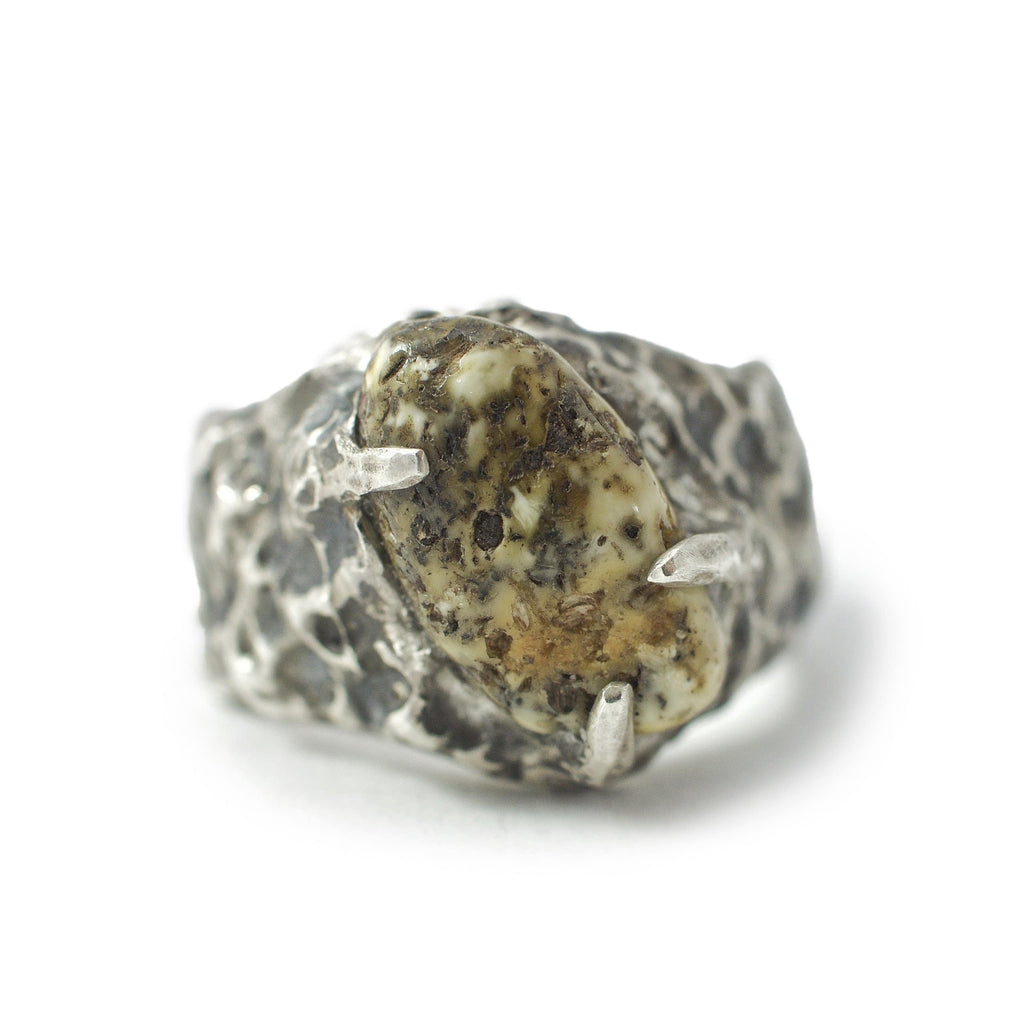 Men's ring Baltic amber raw. Front view.