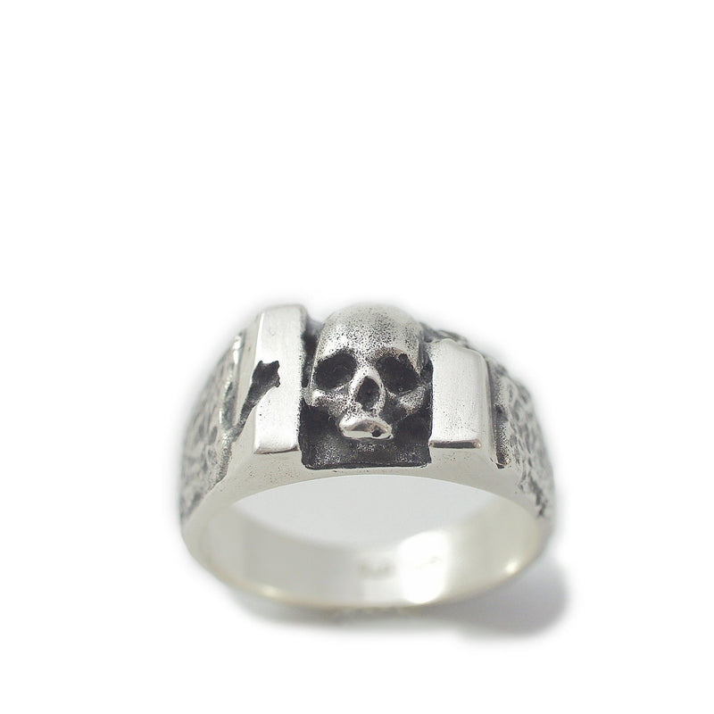 Skull ring Band carved. Standing view.
