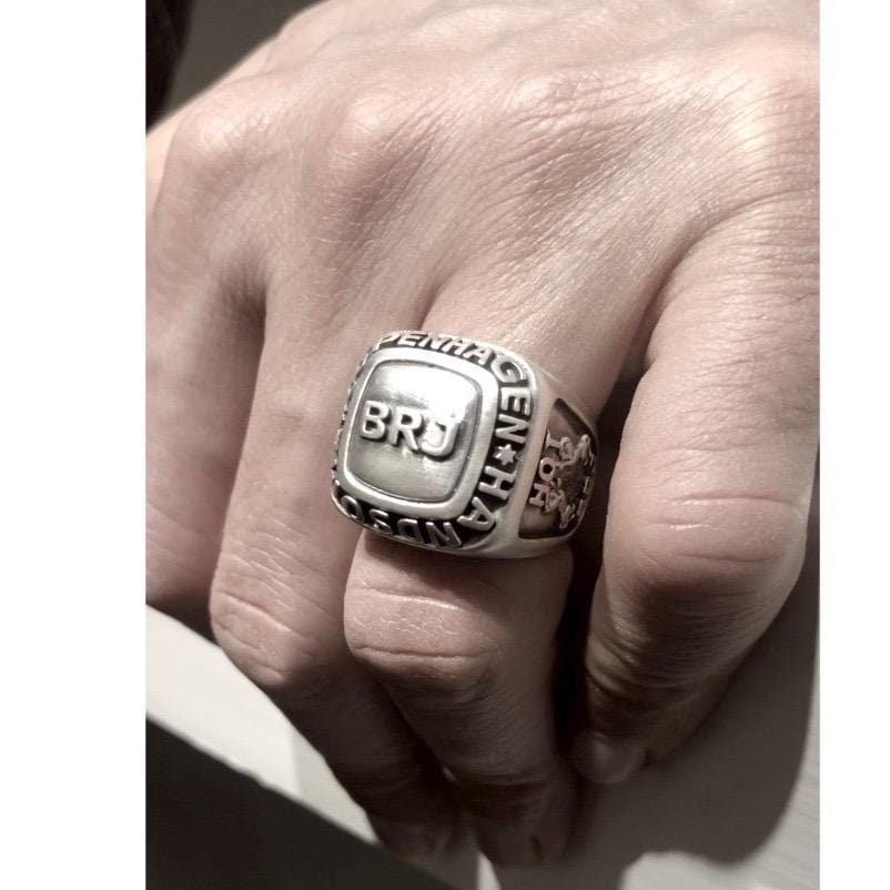 Champion ring on finger