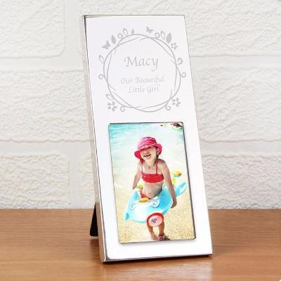 Butterfly Photo Frame. A small silver photo frame with butterflies. Can be personalised. Is made of aluminium.