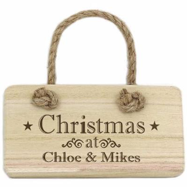 Christmas Wooden Sign. A wooden Christmas sign that can be personalised. It hangs by a thick rustic rope.
