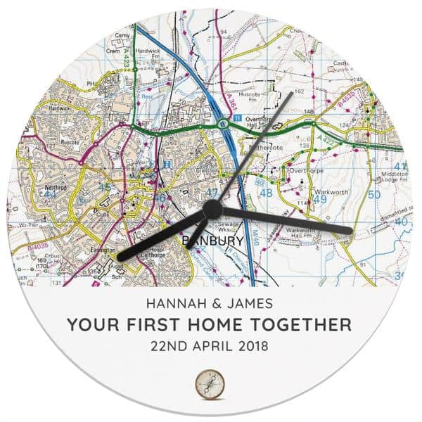 Compass Clock. A wall clock showing a personalised present-day map. Perfect for showing the location of a first home together.