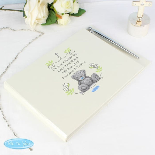 guest book and pen. This book features tiny tatty teddy on the front cover and a cross and can be personalised with any message making it suitable for any religious occasion - christening, first communion, baptism, wedding etc