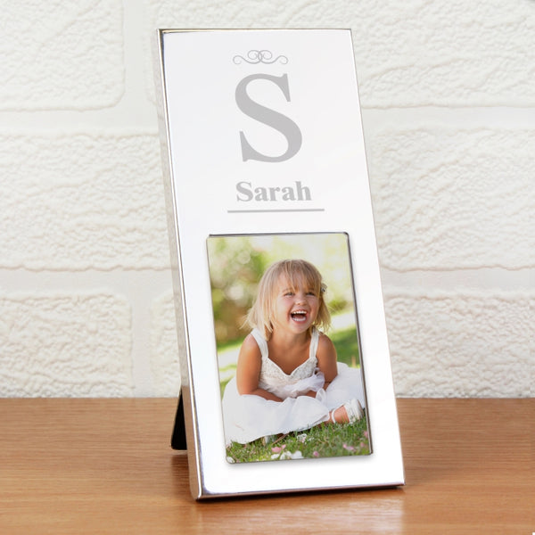initial photo frame. a small silver coloured photo frame that can have an initial and name engraved on it. fits a 2x3 photo.