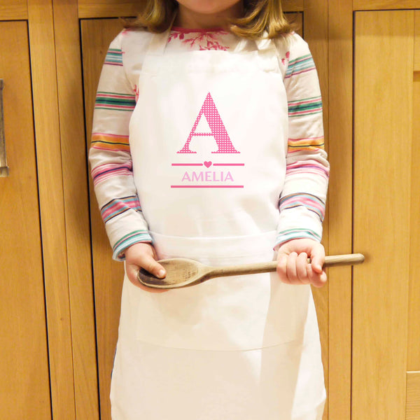 personalised kids apron. an initial and name can be printed on the front of the apron.