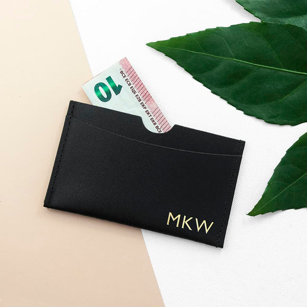 leather card holder. available in 4 different colours. initials or a name up to 6 characters can be personalisedd on it with gold lettering. from Edinburgh CalEli Gifts company