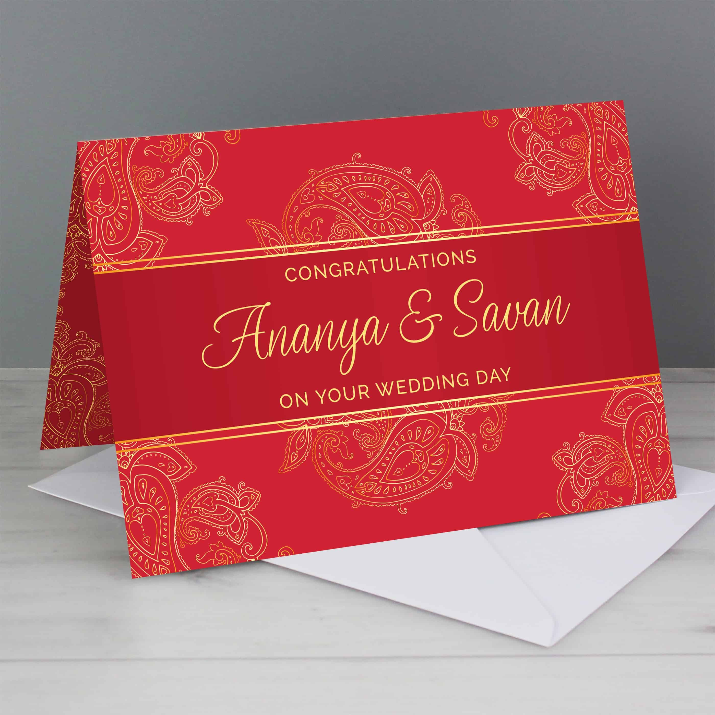 personalised paisley wedding card. A red card that can be personalised with gold writing on the front and inside.