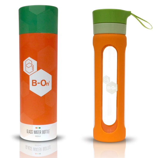 orange and green b on 1 glass bottle