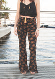 The tiger print bell pant is super light and comfy. These retro inspired bell pants feature a high waist and a tie belt accent and is made with a sweater like fabric.