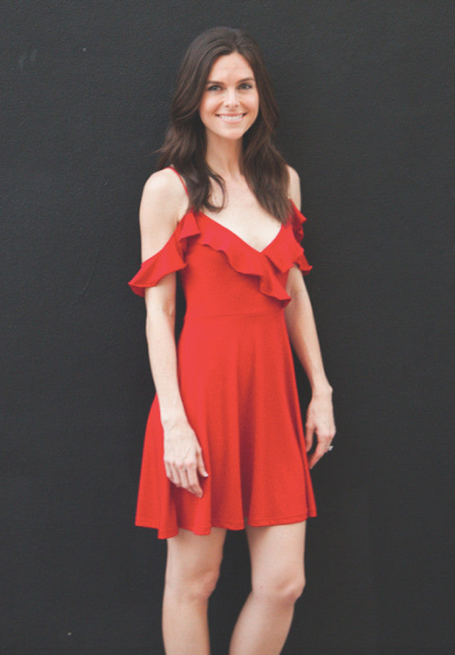 Ruffle neckline skater dress in bold red has a plunge neckline.