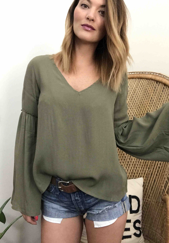 The Sinead Top has all the boho charm with its bell sleeve details. Pair it with shorts for a casual look or jeans and heels for dressier look.