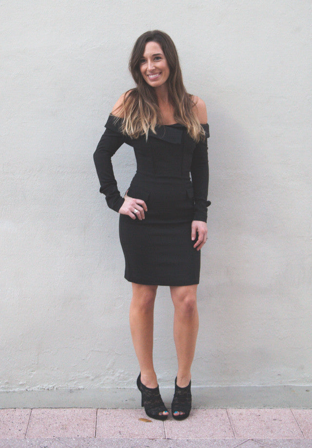 The tuxedo mini dress is cut with a boned bodice and an asymmetric crossover front. Tailored to flatter the body, the design is supremely comfortable and fully lined.