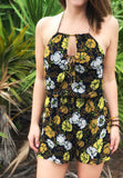 Open back floral romper ties in the front and in the back.