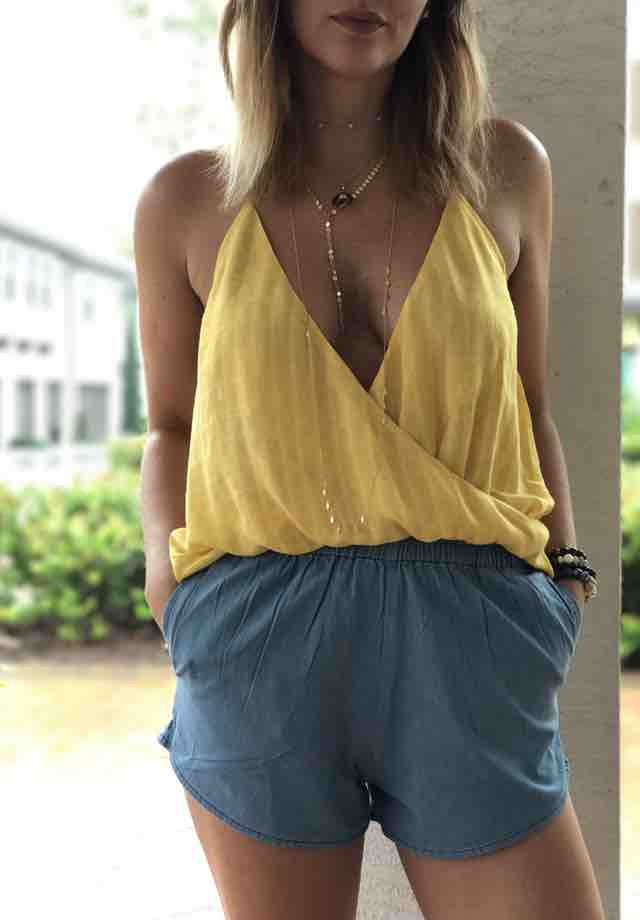 Lily draped halter top adds the perfect amount of sunshine to your summer wardrobe. Wear with causal shorts, jean shorts, jeans or some crisp white pants.