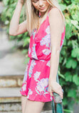Floral romper with cross front and a ruffled bottom.