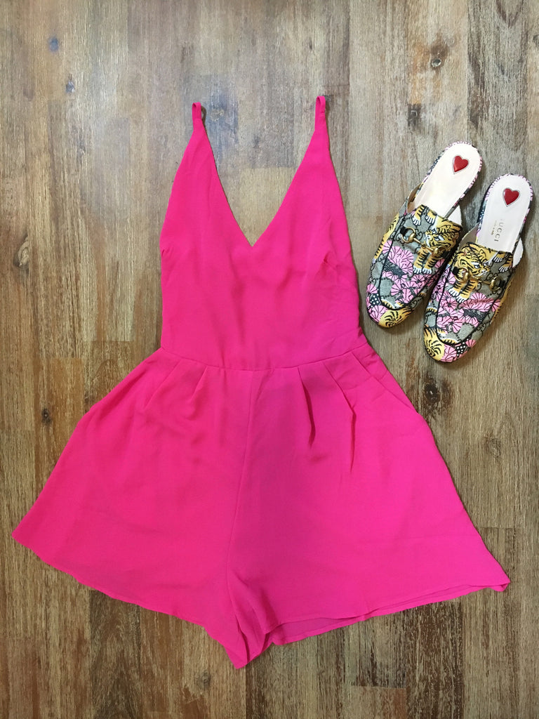 flirty fuchsia romper has an open back with a tie to adjust for comfort and fit.