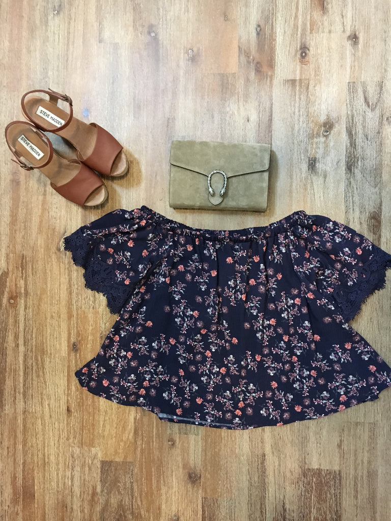 Navy and floral print off the shoulder top with lace detail on the sleeves