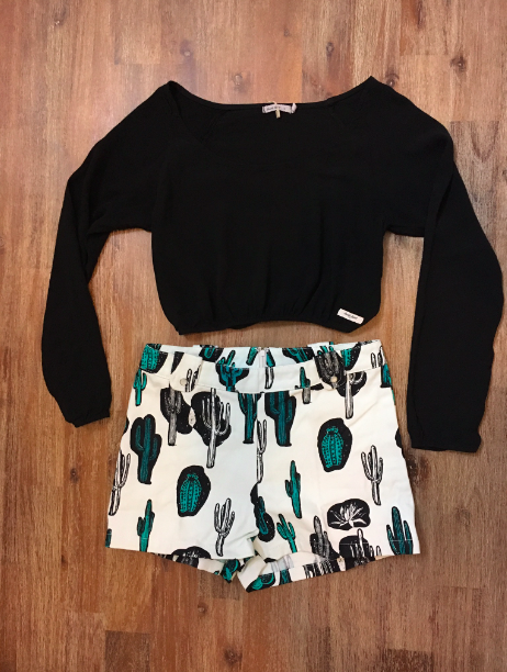 Black scooped neck crop top with elastic waist and sleeves can be worn casual or dressed up with jewelry and heels.