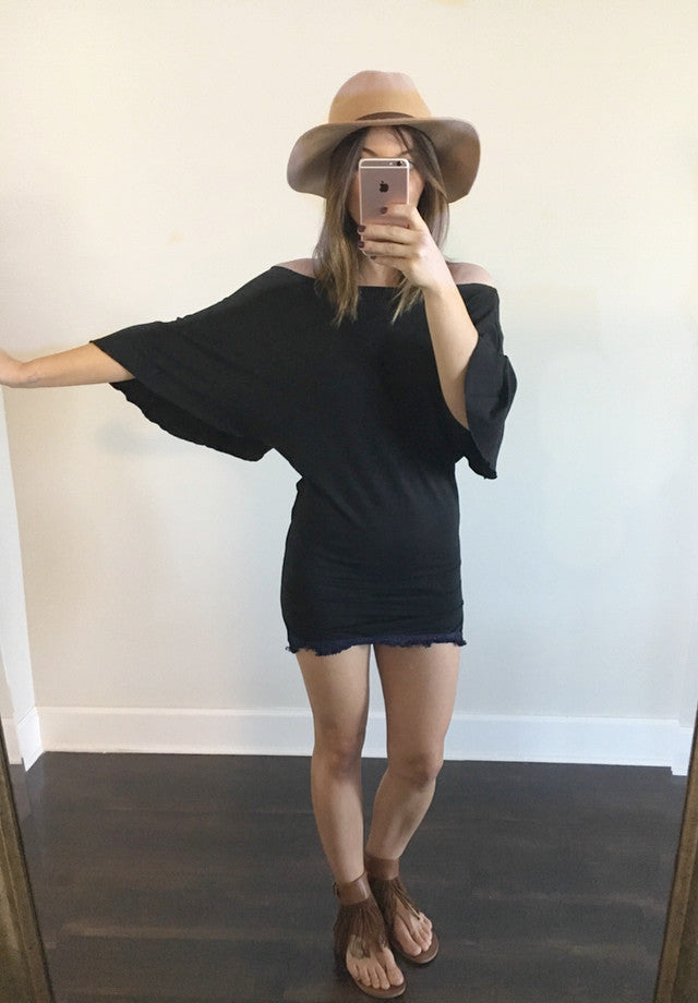 Off the shoulder mini dress/tunic featuring an open back with colorful tribal inspired accents, oversized butterfly sleeves and naturally dyed fringe at the hem.