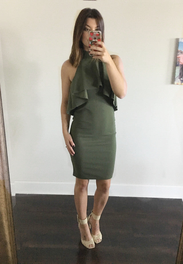 Frill halterneck bodycon dress in olive green has frill detail at the front and back, high neck with button and loop fastening and a bodycon fit.