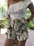 The Elizabeth Floral Tie Front Shorts have an elastic waist with a tie belt and pocket. These shorts are causal and comfortable and can easily go from day to night.