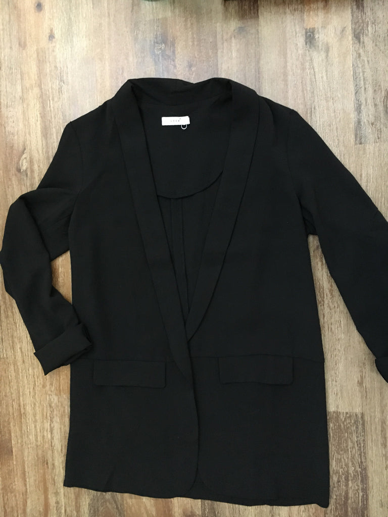 Long sleeve black blazer. This blazer pair perfectly with a pair of jeans for an edgy look or dress up a pair of slacks for a more tailor look.