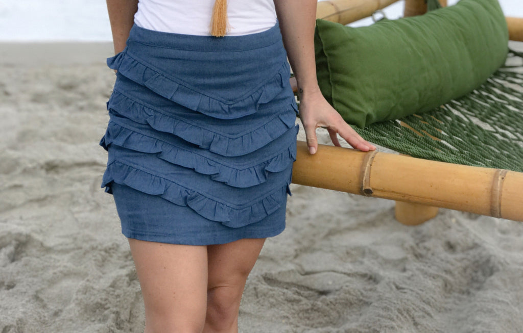 The Pleat Me denim mini skirt with layered gathered frills is the perfect feminine skirt.