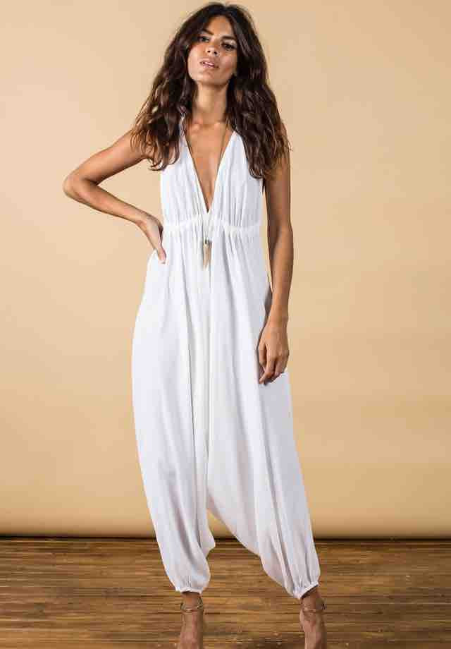 Loose fitting jumpsuit with harem pants and low 'v' to neckline and back. Soft, comfortable fabric perfect for summer days, festivals, holidays or simply lounging around feeling elegant. The bust area is fully adjustable and ties at the neck and back by drawstring so you can fit to flatter your personal size.  One Size