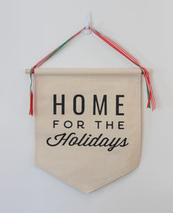 home for the holidays with ribbon