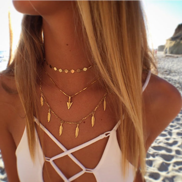 golden arrow necklace by Erin Fader