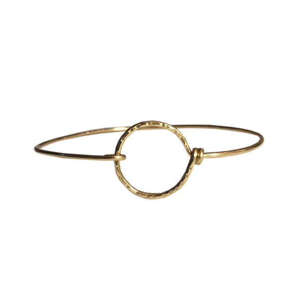 gold hammered circle bangle by Lush Jewelry