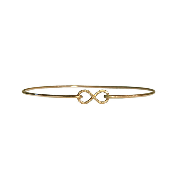 handmade gold infinity bangle by Lush Jewelry