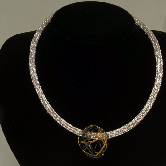 Gold and silver open sphere necklace