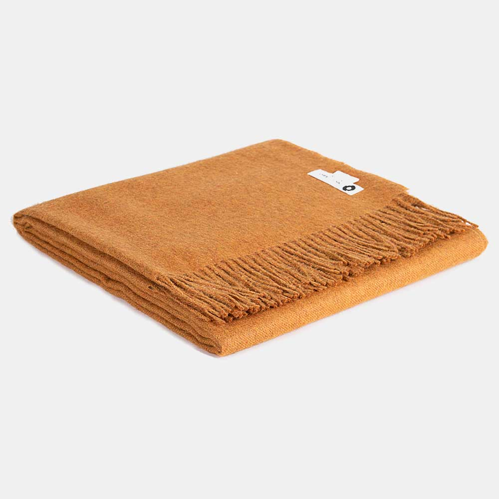 a blanket made of peruvian alpaca wool super soft and hypoallergenic, colour mustard. Price £160.00