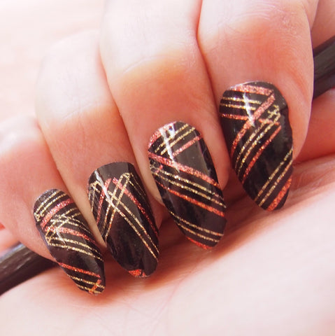 She Owns The Night Black and Gold Glitter Nail Art