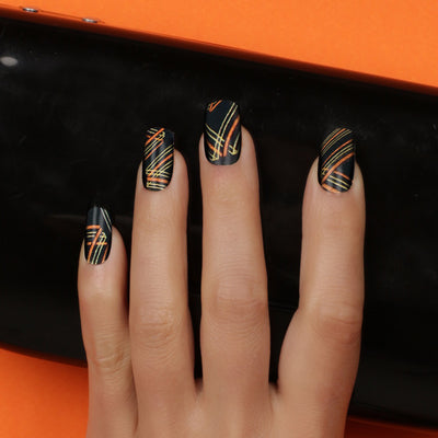 Her Royal Flyness Nail wraps, black and gold nail art, gold glitter nails holding black clutch