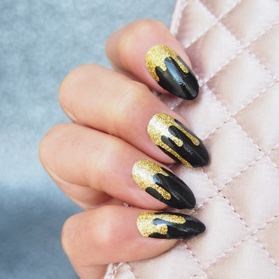 Her Royal Flyness Gold glitter drip nails holding clutch, Nail wraps black and gold