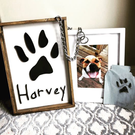 The Paw Print Sign