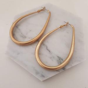 Tear drop statement earrings - Gold