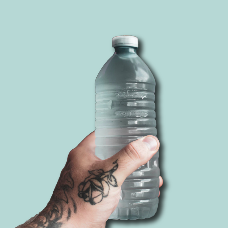 tattooed hand holding plastic bottled water