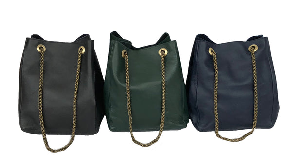 anita bucket bag model. Smooth leather in Navy, Hunter Green and Black.