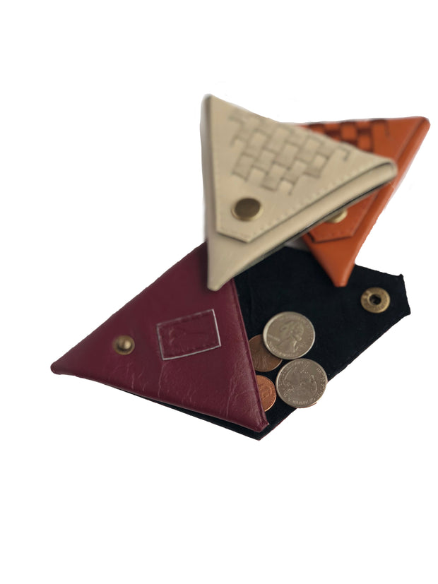 Triangular coinpurse with signature weaving on outside, Available in brick, cabernet and ecru.