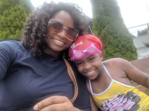 black mom woman with daughter girl natural hair swim