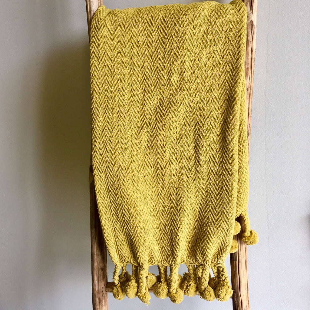 mustard yellow throw with pom pom fringe Living Roots Home Decor Covington Ga