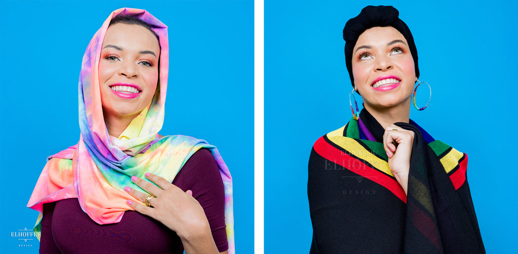 On the left, Blair Imani (a medium skinned hijabi model) wears the neon rainbow tie dye head scarf wrapped around her head, crossed at the front, with the ends draped over her shoulders. On the right, Blair models the black and rainbow striped scarf as a wrap around her shoulders. The scarf is mostly black, with a strong stripe of purple, blue, green, yellow, and red. She wears a black wrap around her head.