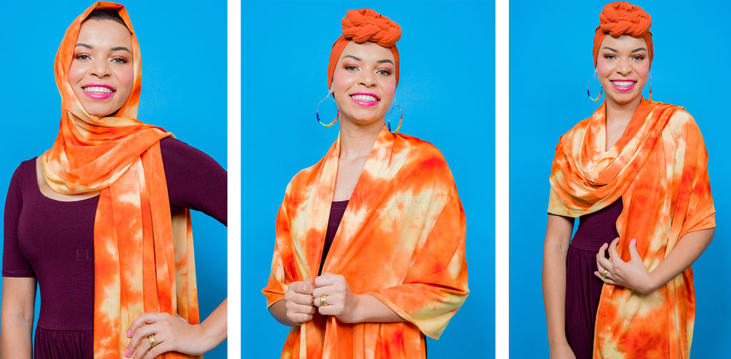 Blair (a medium skinned hijabi model) wears the light and dark orange tie dyed scarf as a head wrap covering her hair and neck in one photo. In the other two photos, she drapes the scarf across her shoulders and a shoulder wrap.