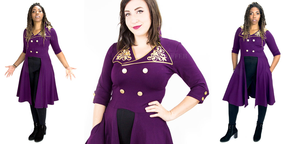 Aabria and Sarah model the purple Lafayette inspired tunic with black leggings. They are on a white background.