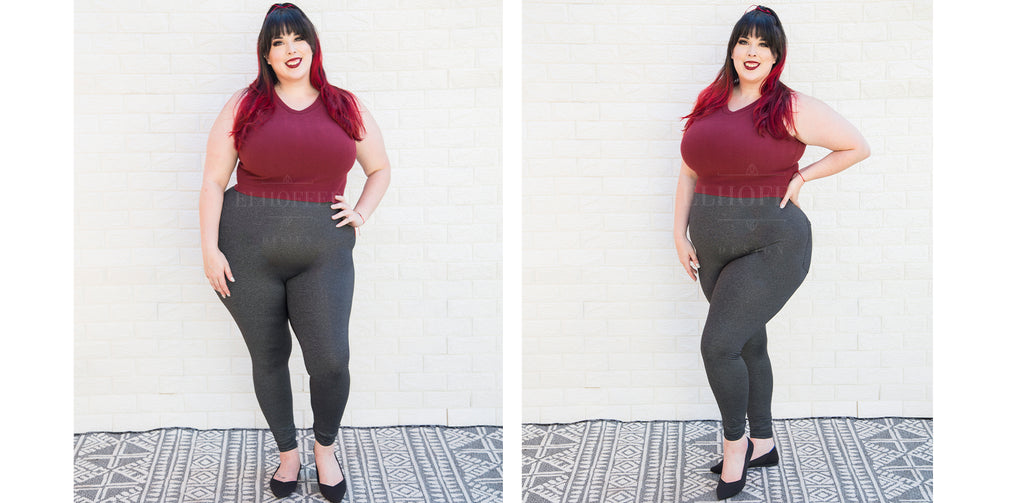 Katie Lynn (a fair skinned size 2X model with black and red hair with bangs) models the heathered grey high waisted leggings. The leggings come up above her natural waist and are fitted to the body. She pairs it with a burgundy crop top.