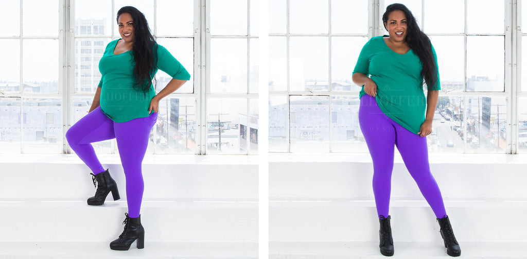 Tas (a medium dark skinned size 2X model with long dark hair) models the high waisted bright purple leggings and pairs it with a kelly green v-neck three quarter sleeve top.