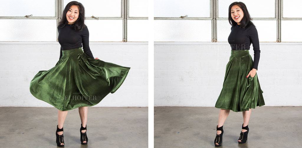 Kate (a medium fair skinned size XS model with dark hair) models the olive green velvet midi skirt, which features a thick waistband, two side pockets, and the hem falls below the knee.